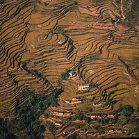 An aerial view of rice terraces in the foothills of Nepal's Himalayan foothills.