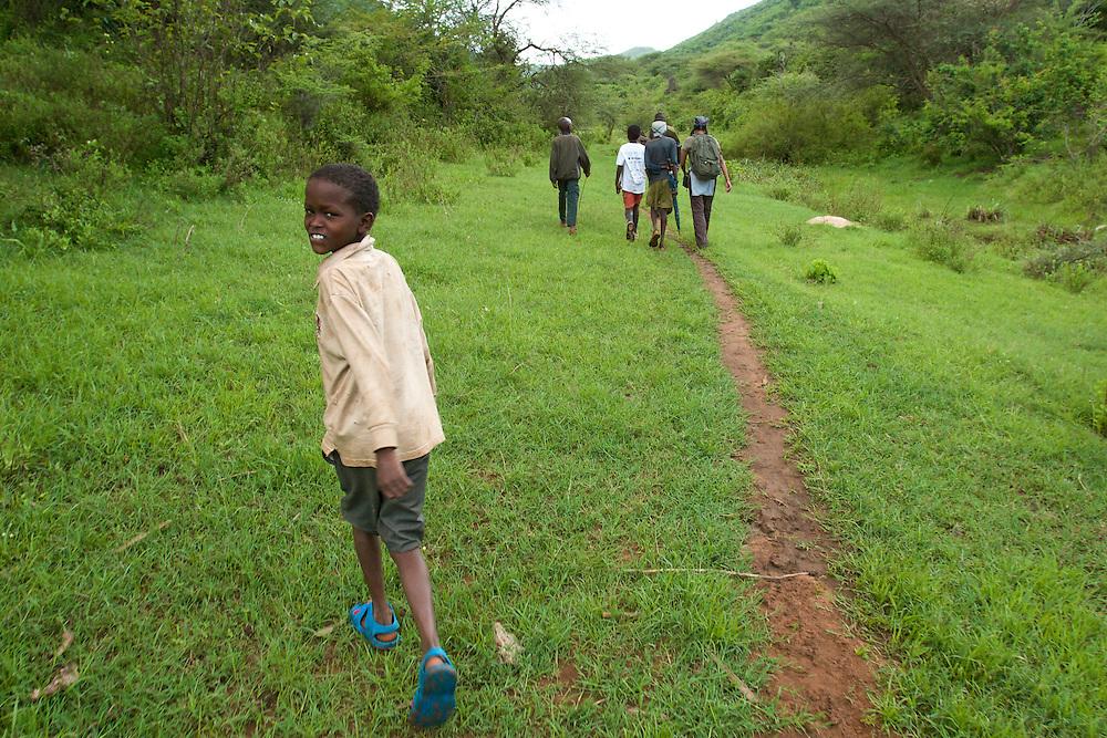 Samburu boys break from minding their herd to accompany scientists upstream to test the water.