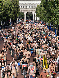 © Licensed to London News Pictures. 14/08/2021. London, UK. Naked cyclists ride along The Mall as they take part in the World Naked Bike Ride in central London. Activists are protesting against the global dependency on oil and are calling for an end to the car culture. Photo credit: Peter Macdiarmid/LNP