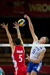 11.09.2014, Centennial Hall, Breslau, POL, FIVB WM, Kuba vs Russland, Gruppe F, im Bild Leandro Macias Infante cuba #5 Alexey Spiridonov russia #9 // Leandro Macias Infante cuba #5 Alexey Spiridonov russia #9 during the FIVB Volleyball Men's World Championships 2nd Round Pool F Match beween Cuba and Russia at the Centennial Hall in Breslau, Poland on 2014/09/11. EXPA Pictures © 2014, PhotoCredit: EXPA/ Newspix/ Sebastian Borowski<br /> <br /> *****ATTENTION - for AUT, SLO, CRO, SRB, BIH, MAZ, TUR, SUI, SWE only*****