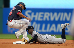 October 6, 2017 - Cleveland, OH, USA - The Cleveland Indians' Edwin Encarnation, left, is injured as he attempts to avoid a double play at second base on a line drive by Jay Bruce in the second inning as New York Yankees shortstop Didi Gregarious covers during Game 2 of the American League Division Series, Friday, Oct. 6, 2017, at Progressive Field in Cleveland. (Credit Image: © Phil Masturzo/TNS via ZUMA Wire)