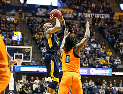 Feb 10, 2018; Morgantown, WV, USA; West Virginia Mountaineers guard Jevon Carter (2) shoots a three pointer during the second half against the Oklahoma State Cowboys at WVU Coliseum. Mandatory Credit: Ben Queen-USA TODAY Sports