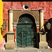 A doorway to an historic Spanish colonial building in Antigua Guatemala. Famous for its well-preserved Spanish baroque architecture as well as a number of ruins from earthquakes, Antigua Guatemala is a UNESCO World Heritage Site and former capital of Guatemala.