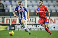 Max Power (Wigan) beats Rory Donnelly (Gillingham) to the ball during the Sky Bet League 1 match between Wigan Athletic and Gillingham at the DW Stadium, Wigan, England on 7 January 2016. Photo by Mark P Doherty.