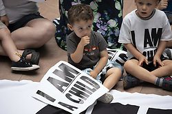 July 26, 2018 - Washington, District of Columbia, United States of America - Parents and children demonstrate against family separation in the Hart Senate Office Building on Capitol Hill in Washington, DC on July 26, 2018. Credit: Alex Edelman / CNP (Credit Image: © Alex Edelman/CNP via ZUMA Wire)