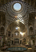 Stunning photographs reveal the beautiful ceilings in Iran's mosques, bazaars and public baths<br /> <br /> For the past few decades, restrictions on travel to Iran has meant the country has been largely shut off from the Western world, butas visa sanctions are lifted in the light of a landmark nuclear deal, the local tourism industry is hoping for a flurry of visitors.<br /> It's not hard to see why Iran is listed as one of the top travel destinations of 2016, with its rich culture and history.<br /> Among the standout aspects of the nation is its beautiful ancient architecture, with the cities and towns littered withornate and eye-catching mosques, public baths and markets.<br /> And unlike many other countries - the roof is not an afterthought, with many ceilings built as the centrepiece to the building, with many of the tile designs showcasing a display of intricate geometric patternsthatdate back several centuries.<br /> French photographerEric Lafforgue has travelled the country photographing the ceilings of indoor markets, mosques and bath houses.<br /> <br /> Photo shows: The dome of Timche Ye Amin Al Dowleh Caravanserai - an old bazaar in the center of the city of Kashan.