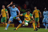 Photo: Ashley Pickering/Sportsbeat Images.<br /> Norwich City v Coventry City. Coca Cola Championship. 24/11/2007.<br /> Darel Russell of Norwich (R) holds off Coventry captain Michael Doyle
