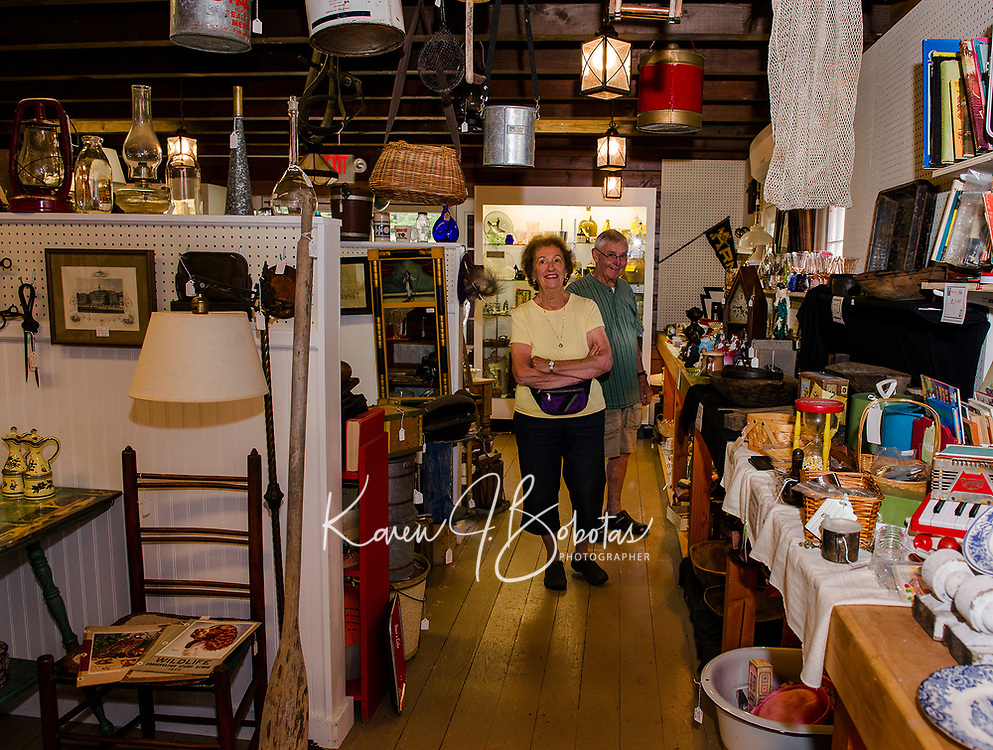 Tina and Bob Mortimer of Falmouth, Maine browse through Paws Antiques on Wednesday afternoon.  (Karen Bobotas/for the Laconia Daily Sun)