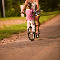 Huahine, French Polynesia, Maeva, girl and mother on bicycle
