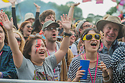 The audience loves watching the Shibusashirazu Orchestra as it  puts on a colourful and eccentric performance on the West Holts Stage - The 2016 Glastonbury Festival, Worthy Farm, Glastonbury.