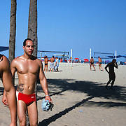 Two male beach goers at the beach volleyball courts in the afternoon sunshine on Copacabana Beach. Rio de Janeiro, Brazil. 12th July 2011. Photo Tim Clayton