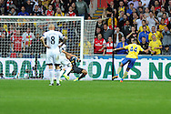 Arsenal's Serge Gnabry (44) scores his sides 1st goal. . Barclays Premier league, Swansea city v Arsenal at the Liberty Stadium in Swansea on Saturday 28th Sept 2013.  pic by Andrew Orchard, Andrew Orchard sports photography.