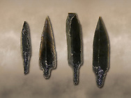 Black obsidian arrow heads. Catalhoyuk Collections. Museum of Anatolian Civilisations, Ankara .<br /> <br /> If you prefer you can also buy from our ALAMY PHOTO LIBRARY  Collection visit : https://www.alamy.com/portfolio/paul-williams-funkystock/prehistoric-neolithic-art.html - Type Catalhoyuk into the LOWER SEARCH WITHIN GALLERY box. Refine search by adding background colour, place, museum etc.<br /> <br /> Visit our PREHISTORIC PLACES PHOTO COLLECTIONS for more  photos to download or buy as prints https://funkystock.photoshelter.com/gallery-collection/Prehistoric-Neolithic-Sites-Art-Artefacts-Pictures-Photos/C0000tfxw63zrUT4