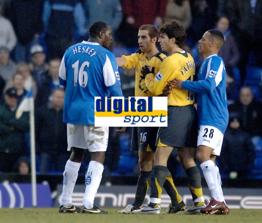Photo: Glyn Thomas.<br />Birmingham City v Arsenal. The Barclays Premiership. 04/02/2006.<br />Birmingham's Emile Heskey (L) gets into a scuffle with Mathieu Flamini and Cesc Fabregas as he refuses to leave the pitch after being shown the red card.