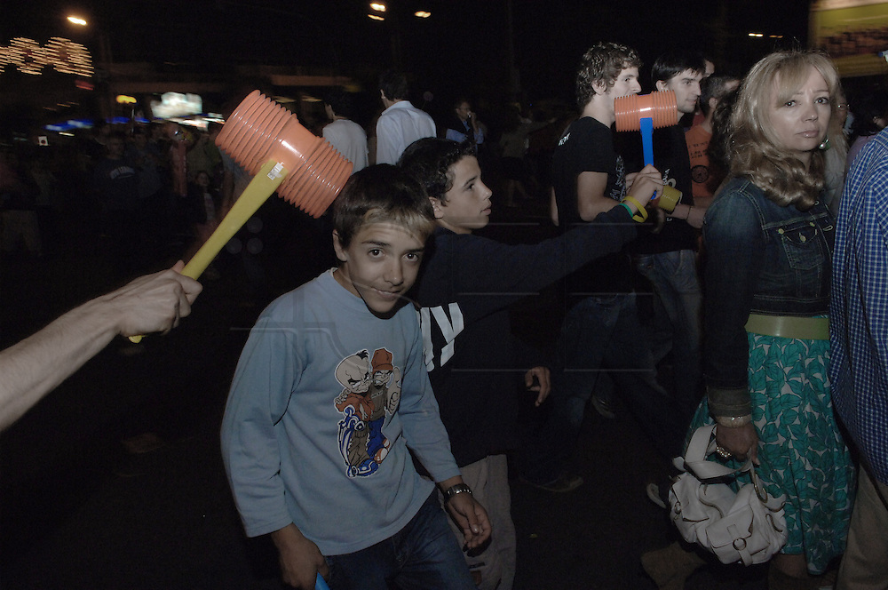 A child playing in the crowd during the São João Party