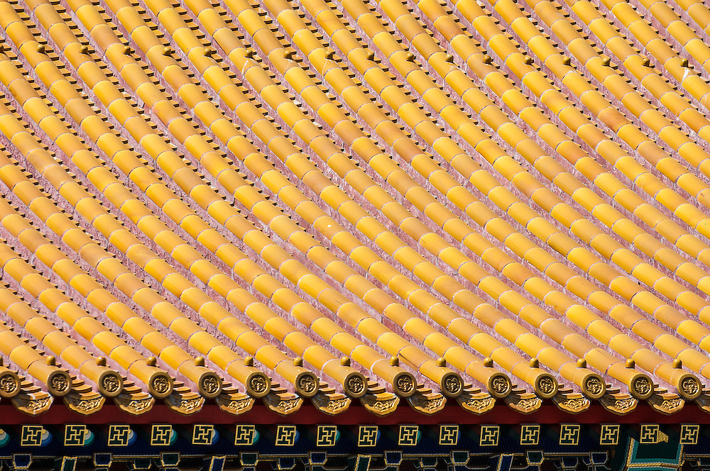 Stock photograph of yellow roof tiles in the Forbidden City in Beijing