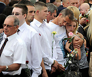 Mourners weep just before the repatriation cortege carrying British servicemen is driven through the town of Wootton Bassett in western England, June 29, 2010. Pic: Paul Hackett