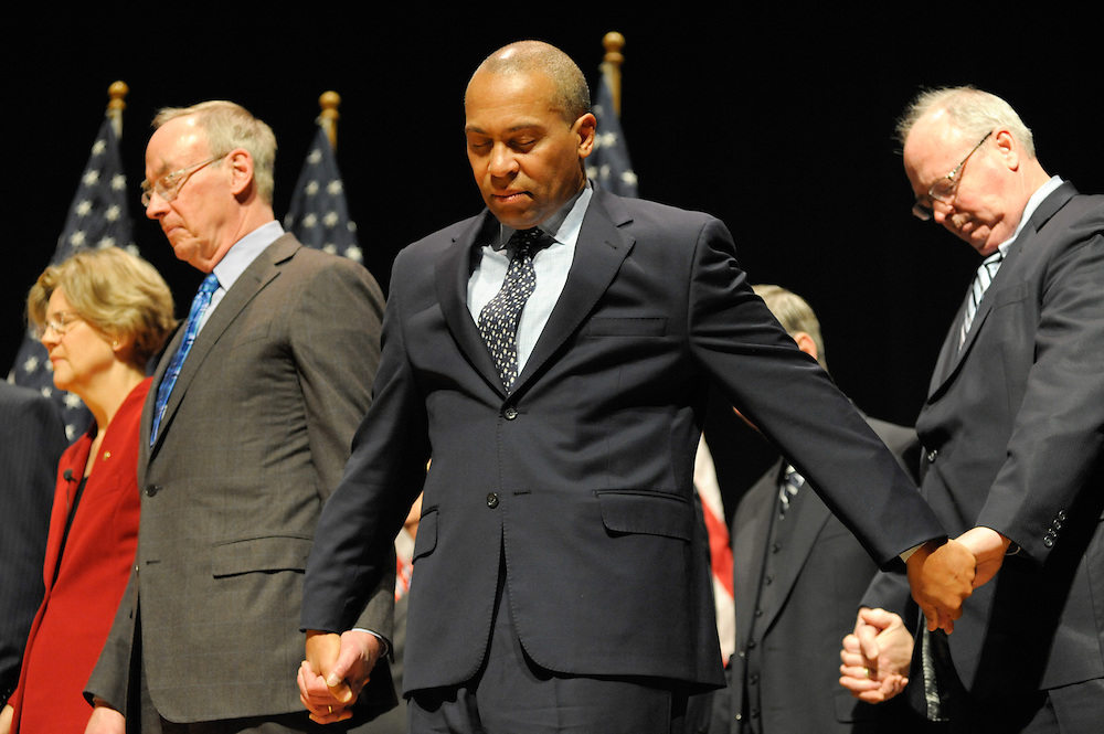 Governor Deval Patrick during a moment of silence during Senator Elizabeth Warren's Massachusetts Swear In Ceremony at the Roxbury Community College.