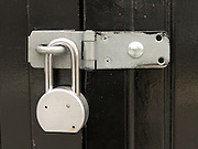 New padlock on freshly painted door.