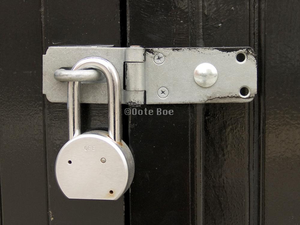 New padlock on freshly painted door.
