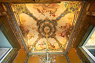"""The workroom of the Queen Mary Caroline. Also called """"the room of Mirrors"""" the frescoed ceiling is by Antonio de Dominici with pairs of mythical figures : Jupiter and Juno, Apollo and Minerva, Mars and the War and Mercury and Prosperpine. The Kings of Naples Royal Palace of Caserta, Italy. A UNESCO World Heritage Site .<br /> <br /> Visit our ITALY HISTORIC PLACES PHOTO COLLECTION for more   photos of Italy to download or buy as prints https://funkystock.photoshelter.com/gallery-collection/2b-Pictures-Images-of-Italy-Photos-of-Italian-Historic-Landmark-Sites/C0000qxA2zGFjd_k<br /> <br /> <br /> Visit our EARLY MODERN ERA HISTORICAL PLACES PHOTO COLLECTIONS for more photos to buy as wall art prints https://funkystock.photoshelter.com/gallery-collection/Modern-Era-Historic-Places-Art-Artefact-Antiquities-Picture-Images-of/C00002pOjgcLacqI"""