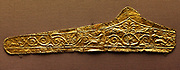 Gold pediment-shaped diadems 330-300 BC. These diadems are made of thin sheet gold with die-formed designs. The most elaborate of them has a central palmette and winged figures on either side with scroll work beyond. The Kyme Treasure contained fragments of at least 11 such diadems: they were probably made especially for the tomb.