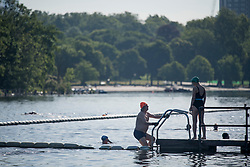 © Licensed to London News Pictures. 20/05/2020. London, UK. Members of the Serpentine Swimming club enjoy the warm weather in the early morning at Hyde Park in London during lockdown. Government has announced a series of measures to slowly ease lockdown, which was introduced to fight the spread of the COVID-19 strain of coronavirus. Photo credit: Ben Cawthra/LNP