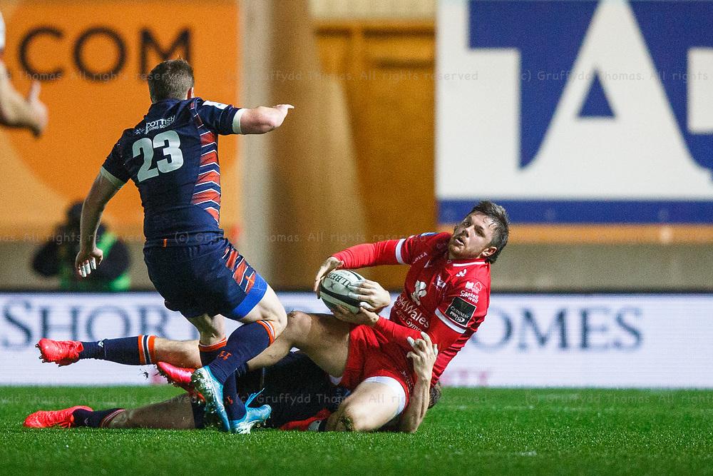 Llanelli, UK. 1 November, 2020.<br /> Scarlets winger Steff Evans is tackled in the Scarlets v Edinburgh PRO14 Rugby Match.<br /> Credit: Gruffydd Thomas/Alamy Live News