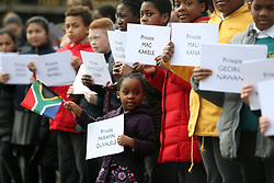 4-year-old Karabo Tigedi waves a South African flag as members of the South African Diaspora Choristers are joined by pupils of St Johns Cathedral Primary School and Chicester Community Choir for a memorial at Portsmouth Guildhall in Hampshire, to those who lost their lives on the troop ship SS Mendi.