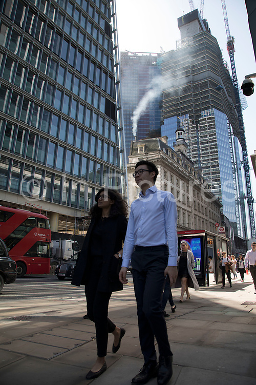 Pollution from the chimney of an old building pours out into the atmosphere amongst modern glass buildings in the City of London, London, England, United Kingdom. At street level, traffic passes adding to the emissions, and all adding up to the poor air quality which people are breathing on a daily basis. London is trying to achieve air quality targets. The European Air Quality Index, run by the European Environment Agency EEA and the European Commission, allows users to check the current air quality across Europe's cities and regions. Environmental groups called for the Government to take urgent steps, including creating and funding clean air zones in pollution hotspots.