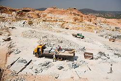 Exploracao Mineral na Serra dos Pireneus, onde encontra-se em grande abundancia o quartzito micaceo, rocha metamorfica de origem sedimentar, tambem conhecida como Pedras Pirenopolis, ou Quartzito Goias. .Suas laminas verdes, amarelas, brancas e rosas, brilhantes por causa da mica, sao utilizadas na construcao civil, para decoracao de pisos, paredes, muros./Mining in Pireneus Mountains where quartizite-micaceo is plentifully founded. It's a methamorphosed sandstone, also known as Pedras pirenopolis or Quartzito Goias.