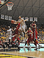 WICHITA, KS - NOVEMBER 12:  Guard Fred VanVleet #23 of the Wichita State Shockers drives to the basket against the Western Kentucky Hilltoppers during the first half on November 12, 2013 at Charles Koch Arena in Wichita, Kansas.  (Photo by Peter Aiken/Getty Images) *** Local Caption *** Fred VanVleet