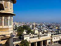 "UDAIPUR, INDIA - CIRCA NOVEMBER 2018: Panoramic view of Udaipur from the City Palace. The city is the historic capital of the kingdom of Mewar. Surrounded by Aravali Range, which separates it from Thar Desert, and full of lakes Udapiur is also known as the ""City of Lakes"" and dubbed as the most romantic spot of the Indian Continent."