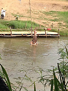 POLICE HUNTING WESTERN TOURISTS SEEN BATHING NAKED IN RIVER<br /> <br /> Police were today hunting two western tourists who sparked outrage after bathing NAKED in Thai river.<br /> <br /> The pair were seen for two consecutive days skinny dipping in the Pai river next to a resort in Mae Hong Son, near the border with Burma. <br /> <br /> They were splashing around in the cool water and scrubbing each other's bodies in front of bemused locals.<br /> <br /> A furious onlooker called police - who sped to the idyllic spot on motorbikes but the couple had already disappeared.<br /> <br /> A local resort owner disgusted by the public nudity shared the pictures online where they went viral - causing outrage among locals.<br /> <br /> The resort owner, who did not want to be identified, said: ''This was disgusting. I called the police but they were were too late and the pair had already left on a motorbike. <br /> <br /> ''And that is not all. Some foreigners are walking down the main street in Pai in bikinis. I know it is a tourist area but there are temples all around there. <br /> <br /> ''Someone needs to talk to them and tell them to cover up and show some respect.''<br /> ©Exclusivepix Media