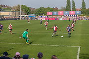Duwlich Hamlet on the attack during the last home game of the season for Dulwich Hamlet Football Club against Woking, who are currently second place in the league, on the 22nd April 2019 in London in the United Kingdom. After a turbulent season, Dulwich Hamlet lost 3 - 1 to Woking, but have secured another season in the National League South.
