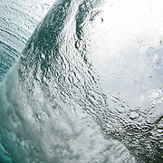 A wave is seen breaking from underwater on a section of Glover's Reef, Belize.