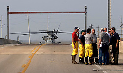 25 Sept 2005. Lake Calcasieu, Louisiana. Hurricane Rita aftermath. <br /> A military helicopter drops FEMA officials close to the bridge connecting Hackberry one day after the storm. FEMA officials meet with local fire, police and civic leaders to discuss their plans.<br /> Photo; ©Charlie Varley/varleypix.com