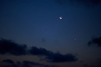 Pre-Dawn View of the Moon, Venus, and Mercury. Image taken with a Nikon D3x and 85 mm f/1.4G (ISO 1600, 85 mm, f/1.4, 1/30 sec). Raw image processed with Capture One Pro 6 and converted to jpg/sRGB with Photoshop CS5. Noise Reduction with Topaz DeNoise 5.0.