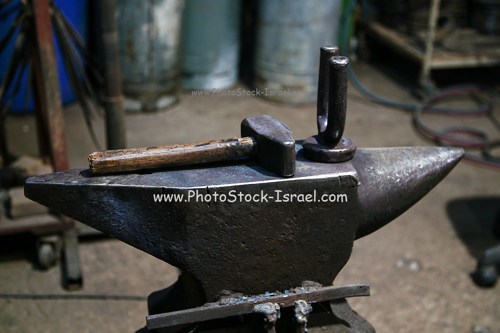 tool of the smith, hammer and anvill in a forge