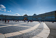 St. Petersburg, Russia -- July 21, 2019. Wide angle photo of people  in the square outside the Winter Palace in St Petersburg, Russia.