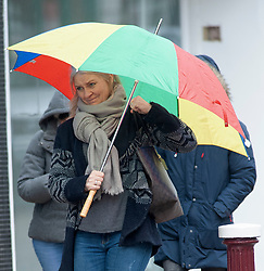 © Licensed to London News Pictures. 29/01/2019. Tunbridge Wells, UK.Umbrellas and hoods up as it starts to rain, people get wet on the High Street in Royal Tunbridge Wells,Kent. Freezing cold wet weather today with snow expected across large parts of the South East tomorrow. Photo credit: Grant Falvey/LNP
