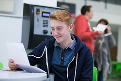 © Licensed to London News Pictures . 20/08/2015 . Salford , UK . JORDAN REED-DELVE gets his results . Students at St Patrick's RC High School in Eccles collect their GCSE results . Photo credit : Joel Goodman/LNP