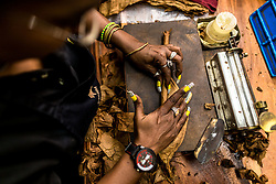"""A worker makes Cohiba cigar at the """"El Laguito"""" factory in Havana, capital of Cuba, on March 3, 2016. Cohiba is the flagship brand of Cuban cigar. It was first created in 1966 for Cuban revolutionary leader Fidel Castro himself and was then top secret. It soon became Cuban gifts for heads of state and visiting diplomats. Since 1982 Cohiba has been available in limited quantities to the open market. The name """"Cohiba"""" is an ancient Taino Indian word for the bunches of tobacco leaves that Columbus first saw being smoked by the original inhabitants of Cuba. EXPA Pictures © 2016, PhotoCredit: EXPA/ Photoshot/ Liu Bin<br /><br />*****ATTENTION - for AUT, SLO, CRO, SRB, BIH, MAZ only*****"""