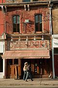 Pedestrians pass the Polish Restaurant Czehoski on Toronto's trendy Queen Street West.