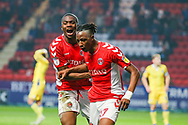 Charlton Athletic midfielder Joe Aribo (17) celebrates with Charlton Athletic defender Anfernee Dijksteel (2) after scoring a goal taking his team to a 2-1 lead during the EFL Sky Bet League 1 match between Charlton Athletic and Bristol Rovers at The Valley, London, England on 24 November 2018.