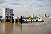 The Ernest Bevin Woolwich Ferry leaving the terminal on the River Thames, with vehicles and and people on board the ferry on October 05, 2018 in London, England on the final day of operation with the old boats.  The Woolwich ferry river crossing service closes from Saturday 6th October until the end of the year to allow new pontoons to be constructed for new boats and the ferry is planned to resume at the end of the year.