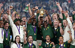Cyril Ramaphosa, President of South Africa lifts the Webb Ellis Cup with Siya Kolisi of South Africa following their victory against England in the Rugby World Cup 2019 at the Yokohama Stadium.