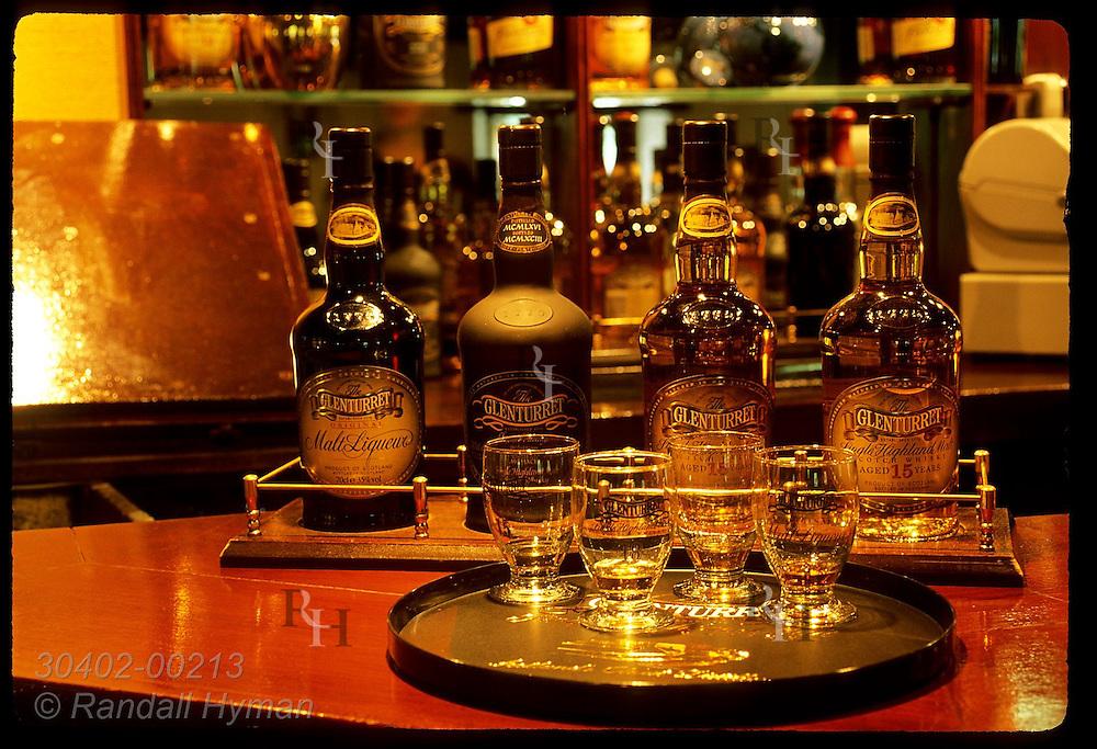 Whisky samples and bottles sit on bar at Glenturret, Scotland's oldest distillery; Crieff. Scotland