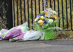 © London News Pictures. 29/07/2013. Manchester, UK. Flowers left at  the scene on Delta Walk, in Moston, Manchester where A father has been stabbed to death and his 13-year-old child left in a critical condition. A second man, who also suffered stab wounds,  died after he crashed a hijacked car into a nearby pub. Photo credit Steve Allen/LNP