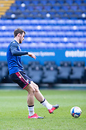 Bolton Wanderers defender Ryan Delaney warming up before the EFL Sky Bet League 2 match between Bolton Wanderers and Cheltenham Town at the University of  Bolton Stadium, Bolton, England on 16 January 2021.